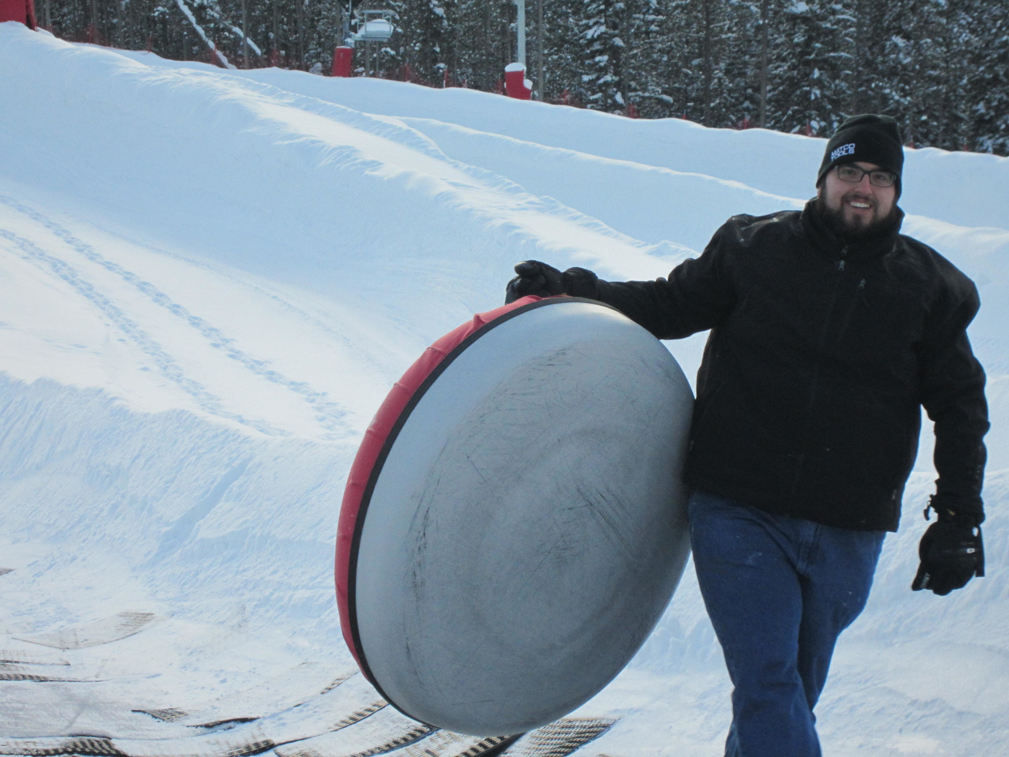 Me, lugging one of the inner tubes at the bottom of the lane. I don't care how old you are, you're never too old to go snow tubing.